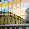 Contrasting architectural styles in reflection