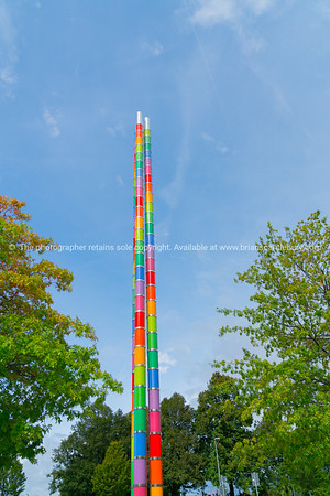 Bright multi-colored totem pole artistic structure in grounds of Mercedes Museum