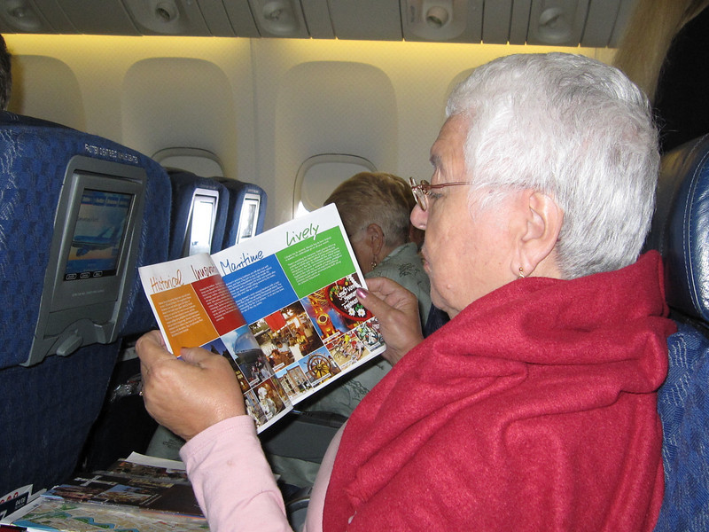 Mom in the plane reading all the places we were going to visit