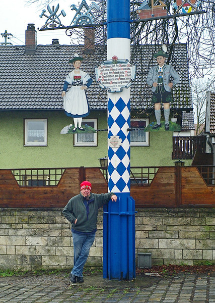 Alex in winter gear next to the town maypole. You find these all over Bavaria.