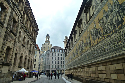 The Fürstenzug, or Procession of Princes is a large mural of a mounted procession of the rulers of Saxony. It was originally painted between 1871 and 1876 to celebrate the 800th anniversary of the Wettin Dynasty, Saxony's ruling family. In order to make the work weatherproof, it was replaced with approximately 23,000 Meissen porcelain tiles between 1904 and 1907. With a length of 102 metres (335 ft), it is known as the largest porcelain artwork in the world. The mural displays the ancestral portraits of the 35 margraves, electors, dukes and kings of the House of Wettin between 1127 and 1904.  The Fürstenzug is located on the outer wall of the Stallhof (Stables Courtyard) of Dresden Castle.