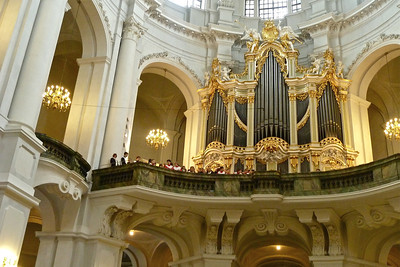 The choir loft was full with singers and musicians to be accompanied by the powerful sounds of the organ.