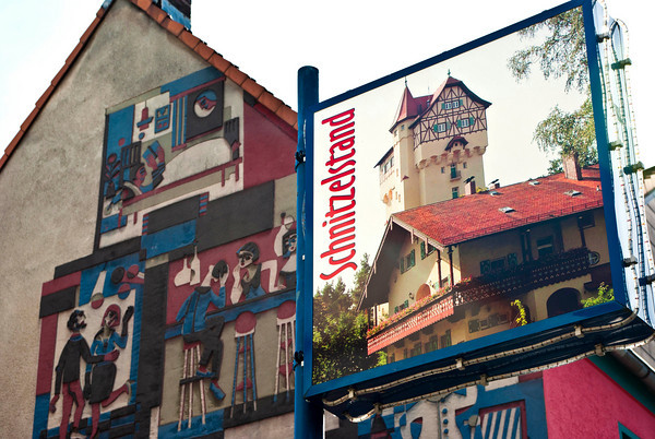 """The tower on the upper side of the Schnitzelstand sign is, of course, """"The Tower"""" on post."""