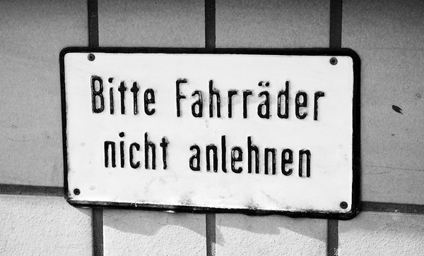"""I believe this means """"do not lean your bikes here.""""  Bitte = Please, Fahrräder = bicycle, nicht = """"not"""" as in """"do not,"""" and anlehnen = """"lean"""" or """"rest."""""""