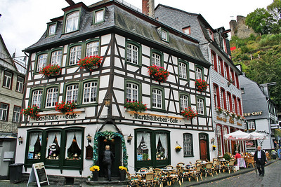 "Almost all the houses in Monschau are made with ""Fachwerk"". This typical German building style is significant because of it's wooden supporting ""balks"" still visible after plastering the wall that is in between them. On top of that this environment has ""lei"" stone roofs."