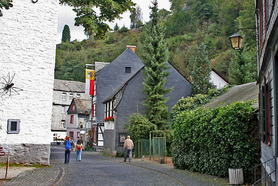 Walking into Old Town Monschau is like a fairy tale come true - the streets are very narrow - spiders on the wall were sculptured by the ironmonger from Sculpure Park