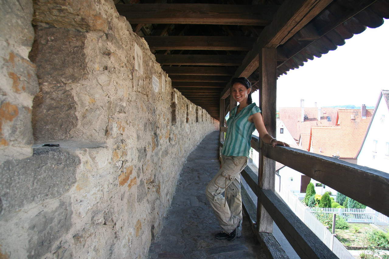 Me on the town wall. Much of the wall was destroyed during WWII but donations from thousands of people (whose names are now displayed on plaques embedded throughout the length of the wall) helped to rebuild it.