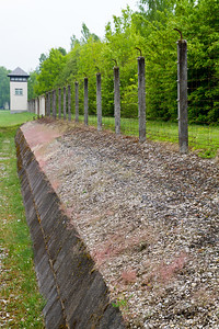 Guard watch tower, ditch and fence left intact Dachau Concentration Camp Dachau, Germany
