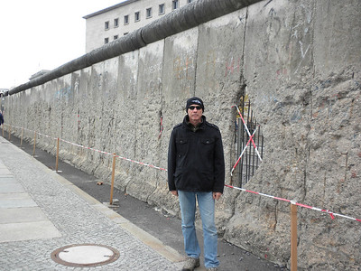 Next to a remnant of the Berlin Wall