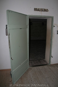 Dachau concentration camp - the entrance to the gas chamber, the word above the door says shower