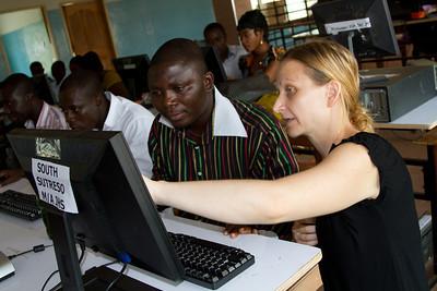 Liz helping Ernest (Opoku Ware)
