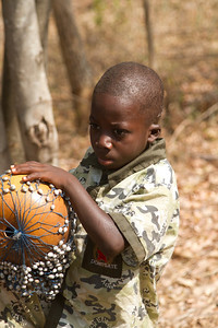 one of the children playing for money