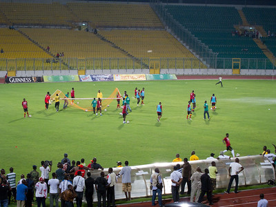 Black Stars players moving the goal to use the other half of the field