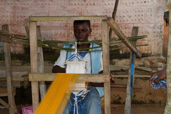 Kente cloth weaving outside