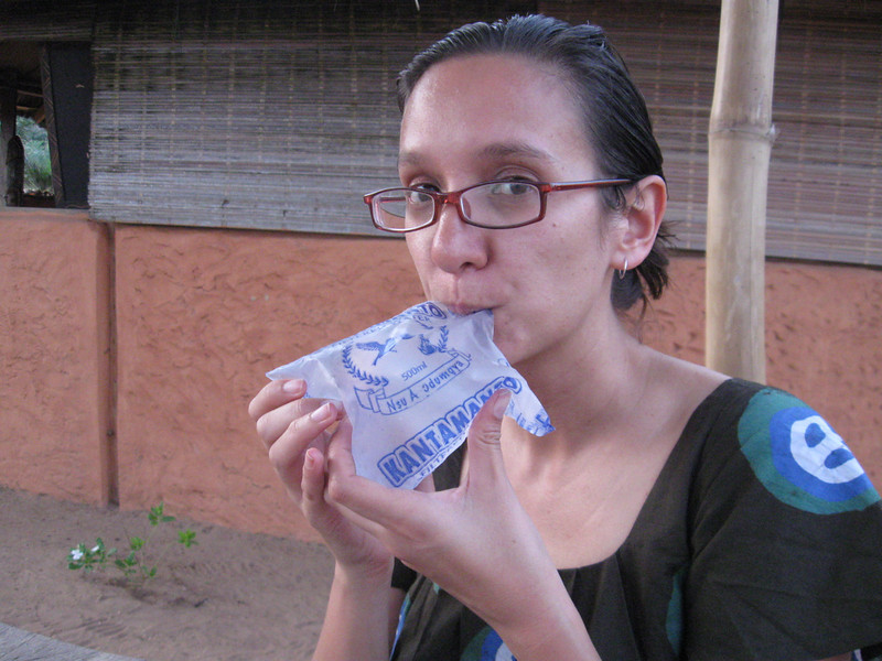 Water sachets, worth a few cents, bought off the head of a young girl and then supped like this. Sort of.
