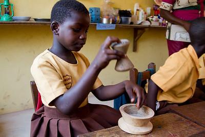 playing at traditional fufu preparation
