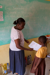 Augustina, the teacher, giving feedback to a student