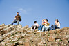 People standing on the top of the Basalt columns at the Giants causeway, Co.Antrim.