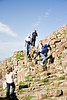 People climbing down the Basalt columns at the Giants causeway, Co.Antrim.