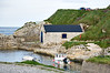 A little boathouse in an Irish harbour on the Antrim coast