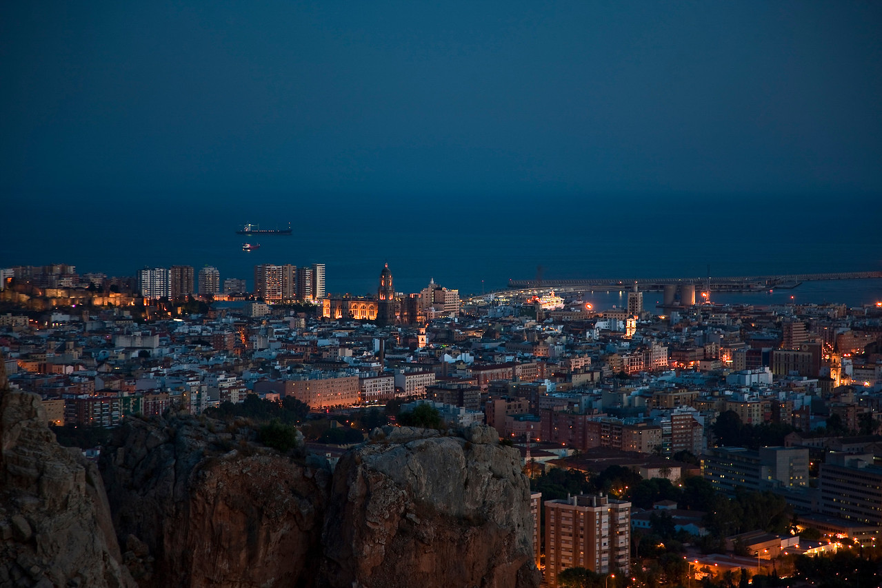 An evening view of Malaga from my own private perch in the rocks.