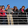 Cruise passengers looking out and enjoying the Glacier Bay view in Alaska.