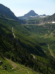 Looking up the valley to Logan Pass.The trail is on the left with Going to the Sun Road below it and the stream at the bottom of the valley.