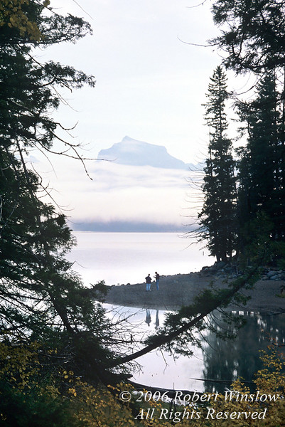 Two People on the Shoreline, Lake McDonald, Glacier National Park, Montana, USA, North America