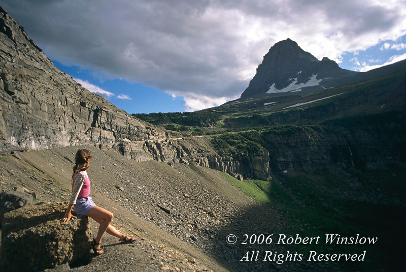 Model Released, Woman on side of Road, Going-to-the-Sun Road, Logan Pass, Glacier National Park, Montana, USA, North America