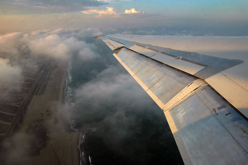 The early morning sun on the wing as we climb out over the ocean.