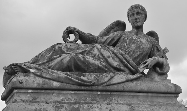 An unusual reclining angel. Works much better in black and white.