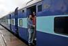 Anu & Suchit at Madgaon railway station. Train ride back to Mumbai from Goa, India during the rains