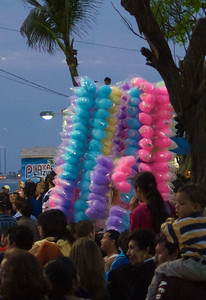 Mazatlán  February 2013  This is the tallest stack of cotton candy I have ever seen. All this is carried on a pole by one person. How do they ever sell that top candy?