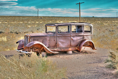 "Old car on Rt 66 out West.  This was a Route 66 ""memorial"" near I-40 (which replaced Rt. 66) alongside of the Petrified Forest National Park road in Arizona"