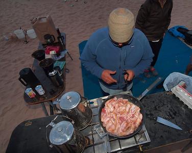 Hmmmm, making bacon on the beach!