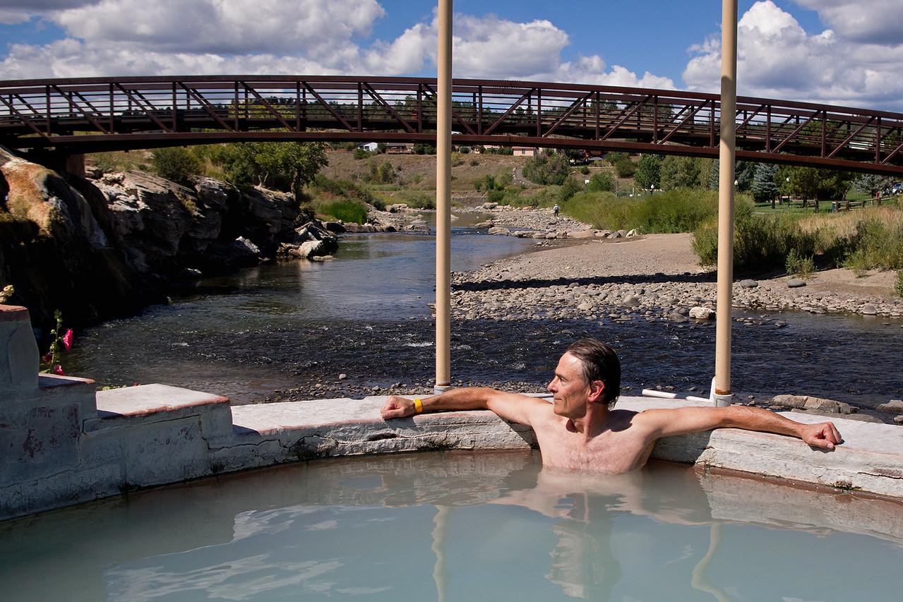 Gary in the hot springs at Pagosa Springs, Colorado. Behind is the San Juan River.