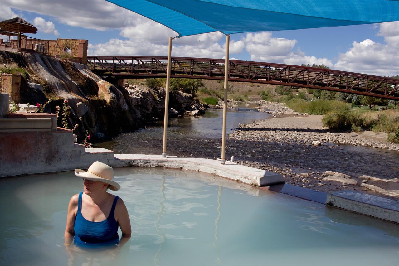Rita in the hot springs at Pagosa Springs, Colorado. The San Juan river in the background.