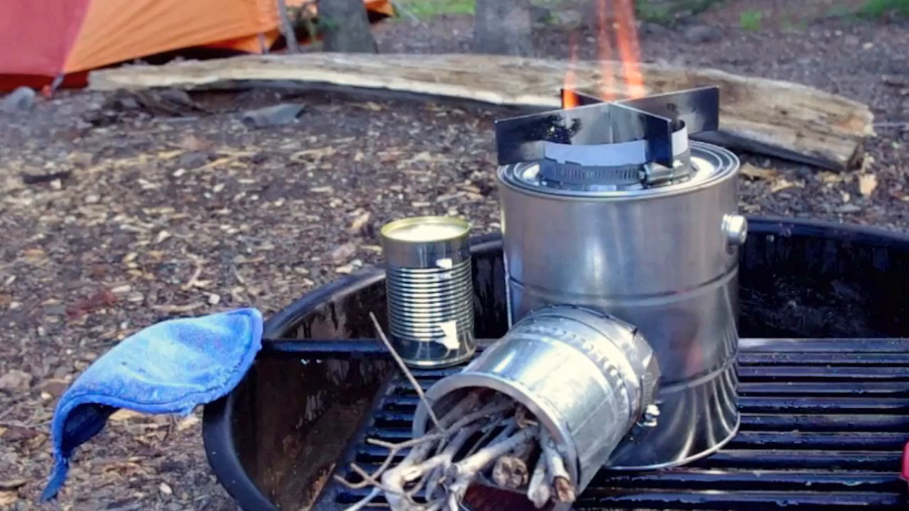 """A short video of Gary demonstrating his hobo rocket stove, made from a gallon paint can, some stove pipe and scrap metal.<br /> <br /> Playback may look really bad at """"Auto"""" resolution; look in the lower right corner of the player for """"Auto"""" and click on it to see if you can play the video at a higher resolution (may take a little longer to load, but ...)"""