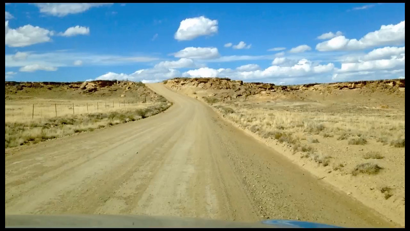 """A short video of the long and bumpy gravel road to Chaco Canyon, from the south. The NPS website warns: """"From the south, two routes access Chaco from Highway 9 … Both routes can vary from very rough to impassable. Not recommended for RVs. If you are traveling from the south, please call ahead for the latest conditions.""""<br /> <br /> Playback may look really bad at """"Auto"""" resolution; look in the lower right corner of the player for """"Auto"""" and click on it to see if you can play the video at a higher resolution (may take a little longer to load, but ...)"""