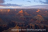 The last rays of the setting sun illuminate only a few places in the Grand Canyon, as viewed from the south rim; best viewed in the larger sizes