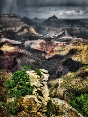 Darker toned version of previous image. I can't decide which I liked best. To me this photo contains all the textures of the canyon  in one image, and the storm creates pools of light that move across the scene, rapidly changing the relationships between the different zones.