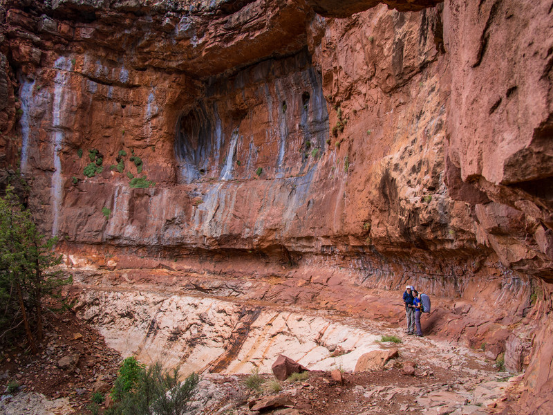 Large sandstone wall with oxidation stains.