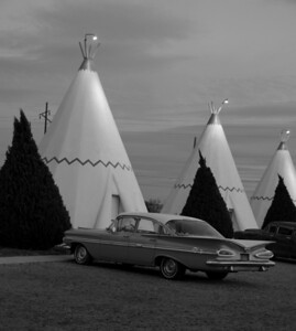 The Wigwam Motel on old Route 66 in black and white.  Nice that they put the old cars in front of the units.