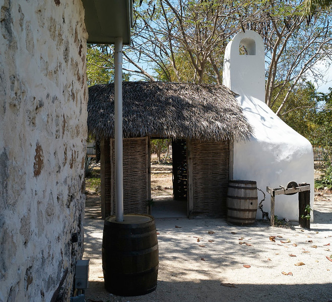 All cooking was done outside the main house in the kitchen. The white structure is the oven at Pedro St. James House.