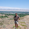 Keith & I hiked to the top of a steep hill to get some panoramic photos. In the near background is the broad Colorado River valley that's the setting for Grand Junction and surrounding communities. The Bookcliff range can be seen in the far background.