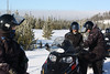 Saddling up on snowmobiles in West Yellowstone for a trip into Yellowstone National Park.  Susan on the left and Dan and Doreen on the right.
