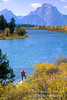 Model Released, Woman Standing by Snake River, Mount Moran in Background, Autumn, Grand Tetons National Park, Wyoming, USA, North America