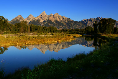 A reflection of the Grand Tetons at 'Schwabacher's Landing'.