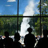 Tourists viewing Old Faithful from the lodge
