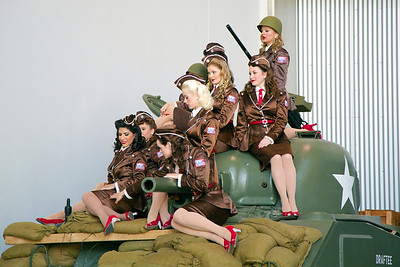 A photo shoot!  1940s-styled women posing on a tank.